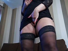 Wicked blond aged slut masturbating on the couch