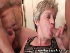 Hot granny dual cock sucking