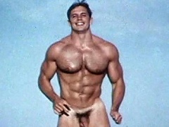 Very hot & athletic gay model poses for the camera naked...