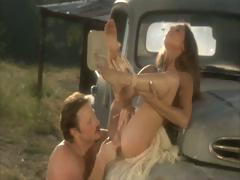 Sexy brunette cowgirl gets her pussy fucked on the old truck next to the barn