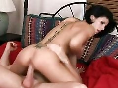 Hot ass brunette with tattooed back rides hard cannon in bedroom