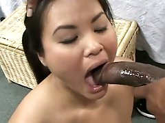 Asian innocent babe getting face fucked by a big black cock !