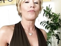 Mature woman stimulates her swollen clit with a large vibrator